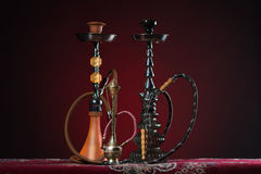 Eastern hookahs on carpet Royalty Free Stock Photos