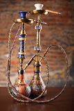 Eastern hookahs on wood table. Isolated in studio close up Stock Images
