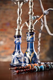 Eastern hookahs on wood table. In studio close up Royalty Free Stock Photos