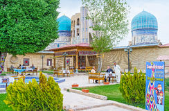 The eastern hospitality. SAMARKAND, UZBEKISTAN - APRIL 30, 2015: The Uzbek restaurant offers the local cuisine and traditional tea, on April 30 in Samarkand Royalty Free Stock Photo
