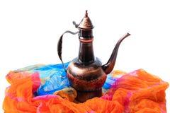 Eastern jug on a orange draped cloth Stock Image