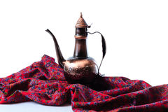 Eastern jug on a violet draped cloth Royalty Free Stock Photo