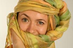 Eastern lady. Lady in a scarf on her head as it  eastern women wear Royalty Free Stock Photography