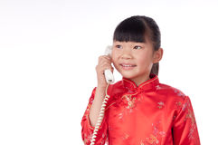Eastern little girl make a phone call Royalty Free Stock Photos