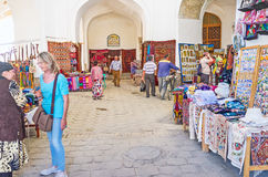 The eastern market. BUKHARA, UZBEKISTAN - APRIL 28, 2015: The interior of the Telpak Furushon Trading Dome, it's the fine place to choose the embroidered Stock Image