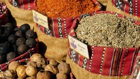 Eastern Market with spices. In UAE. Closeup of bags full of chamomil, safflower, black lemon, thyme, oregano, turmeric, saffron, cardamom. Colourful and stock video