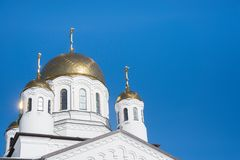 Eastern orthodox crosses on gold domes cupolas againts blue sky - Church, Khimki, Russia stock images