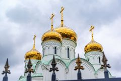 Eastern orthodox crosses on gold domes, cupolas, againts blue sky with clouds. royalty free stock image