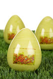 Eastern, painted green easter eggs in grass Stock Images