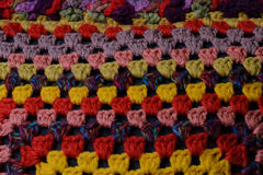 Eastern pattern of bright colors on a pillowcase. Colorful series of large knitted on a pillow Stock Photography
