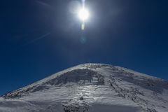 The eastern peak of Mount Elbrus is photographed during the ascent to the western peak Stock Photography