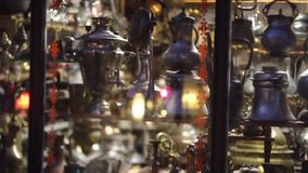 Eastern pitchers stand on a shelf in an turkish shop stock video footage
