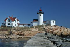 Eastern Point Lighthouse. And breakwater, Gloucester, MA, on a clear spring day stock image