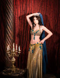 Eastern princess with crown. Attractive, sensual woman in luxury palace Stock Images