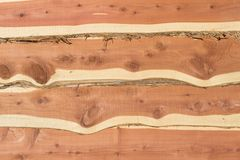 Eastern red cedar bark edge boards. Overlapping with contrasting heartwood and sapwood and knots Royalty Free Stock Photo