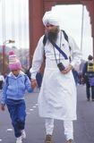 Eastern religious person walking across the Golden Gate Bridge in San Francisco California Stock Image