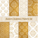 Eastern seamless patterns. Set in gold white colors. Stock Photos