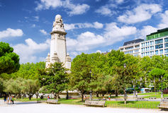 Eastern side of the Cervantes monument on the Square of Spain (P. Laza de Espana) in Madrid on the blue sky background with white clouds in summer time. Madrid Stock Images