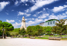 Eastern side of the Cervantes monument on the Square of Spain. (Plaza de Espana) in Madrid on the blue sky background with white clouds in Spain. Madrid is a Royalty Free Stock Image