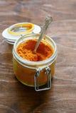 Eastern spice turmeric in a jar Royalty Free Stock Photos