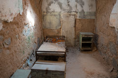 Eastern State Penitentiary. Cell in disarray with incoming window light Stock Images
