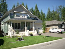 Eastern styled house & yard. Some new houses in the central interior of BC. Canada are been built like the house in the Rockies in Alberta and in eastern Canada Stock Images
