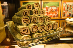 Eastern sweetness - rolls with chocolate on a glass tray Royalty Free Stock Photos