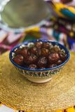 Eastern sweets in the dishes of the Middle East with gold and on Tatar cloth stock image