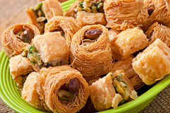 Eastern sweets. On green plate Stock Image