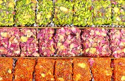 Eastern sweets with nuts. Arabic sweets with rose leaves and pistachios , close up shot Royalty Free Stock Photos
