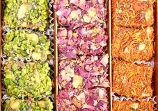 Eastern sweets with nuts. Arabic sweets with rose leaves and pistachios , close up shot Stock Images