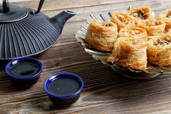 Eastern sweets, teapot and two bowls Stock Image