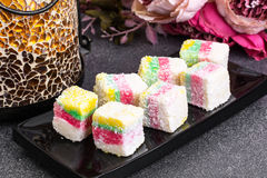 Eastern sweets Turkish delight in color coconut chips Stock Photos