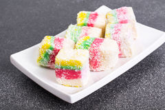 Eastern sweets Turkish delight in color coconut chips Royalty Free Stock Image