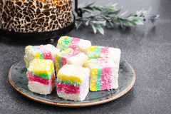 Eastern sweets Turkish delight in color coconut chips Stock Images