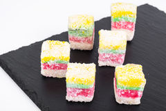 Eastern sweets Turkish delight in color coconut chips Stock Image