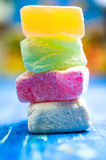 Eastern sweets, Turkish delight. Pieces of colored Turkish Delight closeup stock image