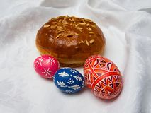 Eastern traditional gift: breaded cake and painted eggs Royalty Free Stock Photography