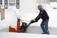 Eastern US Snow Storm. A snow storm in the eastern United States dump 18-24 of snow. A Maryland residence gets use out of their snow blower Stock Photos