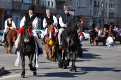Eastern village horsemen. Every March, the Bulgarian community in Targoviste city of Romania celebrates the Eastern of the horses. People thank the horses for Stock Photo