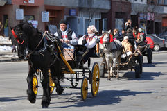 Eastern village line. Every March, the Bulgarian community in Targoviste city of Romania celebrates the Eastern of the horses. People thank the horses for their Stock Image