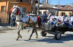 Eastern village youth. Every March, the Bulgarian community in Targoviste city of Romania celebrates the Eastern of the horses. People thank the horses for their Royalty Free Stock Images