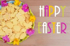 Eastern wish with animal cookies decorated by spring colorful blossoms Royalty Free Stock Photos