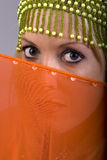 Eastern Woman. Beautiful woman with orange veil Stock Photos