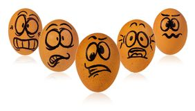 Easter eggs, painted in a terrified cartoon funny faces of a guy. Easters egg, painted in a terrified cartoon funny faces of a guys. Decorated scared eggs in a Stock Photo