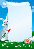 Easters  letter. Funny easter rabbit, letter and egg at spring green landscape Royalty Free Stock Images