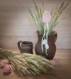 Easters still life from painted eggs, raw wheat Royalty Free Stock Photo