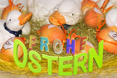 Eastest with geese and painted Easter eggs. Easter, cute geese and eggs. Funny decoration royalty free stock image