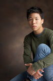Easy. Portrait of a young asian man Stock Photography
