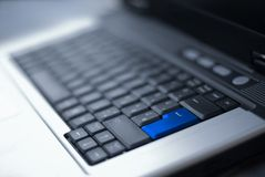 Easy access. A picture of a laptops keyboard with an emphasised enter button in the foreground royalty free stock images
